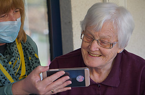 How to Take Control of Your Own Life - elder looking at cellphone