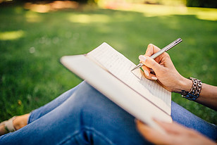 Writers Block Solutions - writing in a park