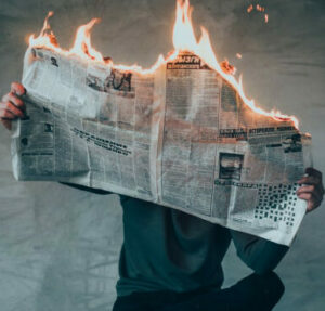 What is a Winning Attitude - burning news paper