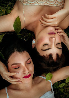 How to Make Law of Attraction Work - two women laying together