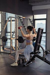 Why it's important to be happy - woman weight training