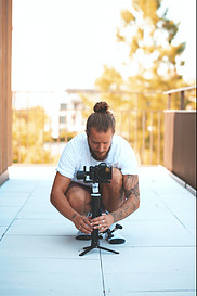 What Is the Best Way to Start a Blog? - Man taking a video