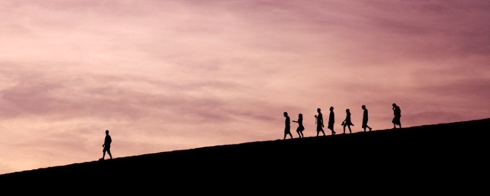 What Is The Meaning Of Leadership? - group walking with leader in front